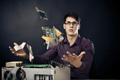 Confused Nerd With Lots Of Hardware. Confused nerd with lots of computer hardware royalty free stock photography