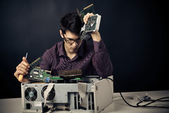 Confused Nerd With Lots Of Hardware. Confused nerd with lots of computer hardware stock photos