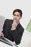 Confused office worker Royalty Free Stock Photo