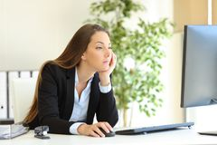 Confused office worker checking computer content royalty free stock photos