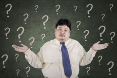 Confused overweight businessman Stock Image