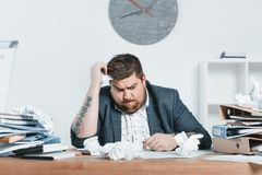 confused overweight businessman in suit working with documents stock photos