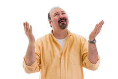 Confused perplexed man asking for clarification. From Heaven raising his hand with a bemused expression, part of a series on body language, isolated on white Stock Image