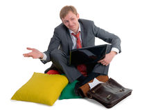 The confused person. Sits having crossed feet at home royalty free stock photography