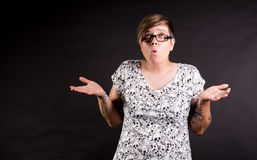 Confused person. Woman against black background looking confused royalty free stock images