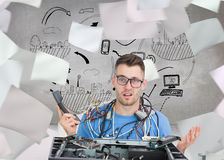 Confused it professional with cables and phone in front of open cpu Stock Images