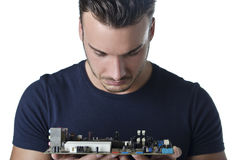 Confused, puzzled computer technician looking at motherboard Royalty Free Stock Image