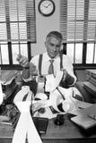 Confused retro accountant checking bills Stock Photo