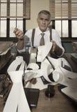 Confused retro accountant checking bills Stock Photos