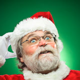 Confused Santa Claus Scratching His Head stock photography