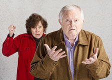 Confused Senior Male. Confused elderly men with angry older woman Stock Photo