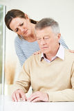 Confused Senior Man With Adult Daughter At Home royalty free stock images
