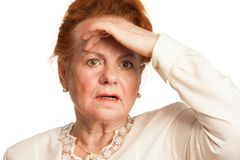 Confused senior woman. Experiencing memory loss Royalty Free Stock Photo