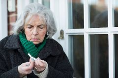 Free Confused Senior Woman Trying To Find Door Key Royalty Free Stock Image - 108300366
