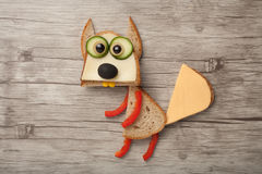 Confused squirrel made of bread and vegetables on wooden backgro Royalty Free Stock Photo