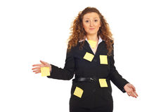 Confused stressed executive woman. With reminder notes on her suit need help isolated on white background royalty free stock images