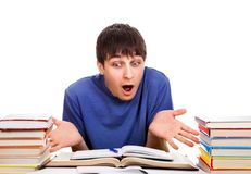 Confused Student with a Books Stock Photo