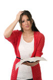 Confused student reading a book Royalty Free Stock Images