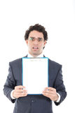 Confused and stunned young businessman posing with white board Stock Photo