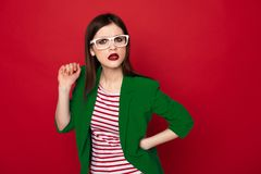 Confused stylish brunette lady isolated on red. Do you really mean it. Waist up portrait of young stylish brunette woman in casual business look and white royalty free stock image