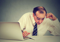 Confused surprised business man looking at documents. Royalty Free Stock Photo