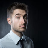 Confused surprised man Stock Images