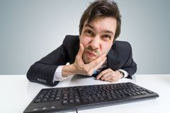 Confused or suspicious businessman is working with computer.  Royalty Free Stock Images