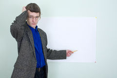 Confused teacher showing on the poster Royalty Free Stock Photo
