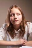 Confused teen schoolgirl Stock Photo