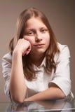 Confused teen schoolgirl Stock Photos