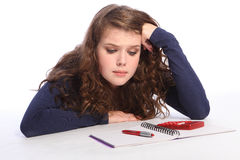 Confused teenager girl fed up with maths homework Stock Images