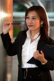 Confused Thai businesswoman. Confused pretty Thai businesswoman,oriental office lady Royalty Free Stock Images