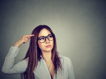Confused thinking woman bewildered scratching head seeks solution Royalty Free Stock Photography