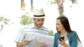 Confused tourists searching location on vacation stock footage