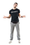 Confused uncertain bouncer or plainclothes officer shrugging shoulders. Full body length portrait isolated on white studio background Stock Photo