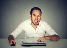 Confused upset man working on computer Royalty Free Stock Photo