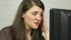 Confused and upset young woman discovers cheating husband on computer stock video