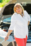 Confused woman and a broken car. In a journey Stock Photos