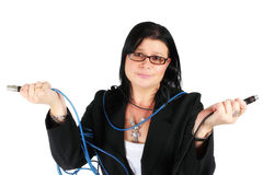 Confused woman with cables Royalty Free Stock Images