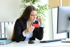 Confused woman calling bank about wrong credit card stock photos