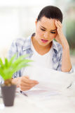 Confused woman financial Stock Image