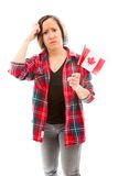 Confused woman with holding Canada flag Stock Photo