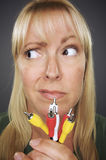 Confused Woman Holding Electronic Cables Royalty Free Stock Photo