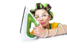 Confused woman or housewife with iron. Young female ironning, isolated on white background Stock Photos