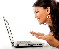 Confused woman with laptop Stock Image