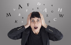 Confused woman with letters around her head Royalty Free Stock Photos