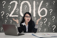 Confused woman with numbers 2016 Stock Photos
