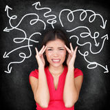 Confused woman - people feeling confusion. And chaos. Indecisive, disorientated and bewildered woman stressed with headache over decision making. Girl in 20s on Royalty Free Stock Photo