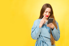 Confused woman with phone Stock Images