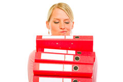 Confused woman with pile of folders Royalty Free Stock Images